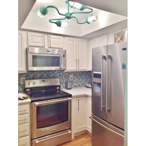 Orbiter 4-Light Chandelier, 311-Jadite Finish, CGG-Standard Cast Guard | Photo Courtesy of Customer