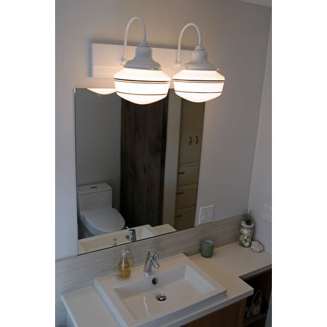 The Collegiate 2-Light Schoolhouse Vanity Light, Opaque Glass, Mounting and Fitter in 200-White, Triple Painted Band in 100-Black | Photo Courtesy of Homeowner