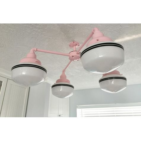 The University 4-Light Schoolhouse Chandelier, Small Opaque Glass, 480-Blush Pink Fitter, Canopy & Stem Finish, Double Painted Band in 100-Black | Photo Courtesy of Homeowner